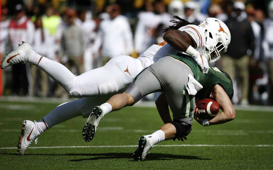 WACO, TX - OCTOBER 28: Malik Jefferson #46 of the Texas Longhorns sacks Charlie Brewer #12 of the Baylor Bears in the second half at McLane Stadium on October 28, 2017 in Waco, Texas. Texas won 38-7. (Photo by Ron Jenkins/Getty Images) Photo: Ron Jenkins, Stringer / 2017 Getty Images