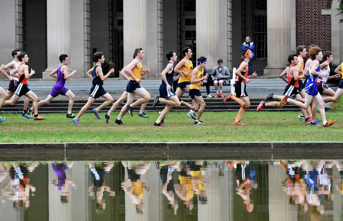 Runners in the Class B boys Section II championship cross country meet start their race through Saratoga Spa State Park on Friday, Nov. 3, 2017, in Saratoga Springs, N.Y. (Will Waldron/Times Union)