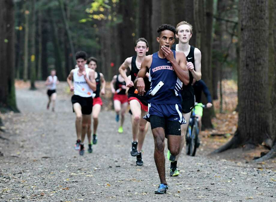 Maazin Ahmed of Schenectady heads out of the forest and on to win the Class A boys sectional cross country meet at Saratoga Spa State Park on Friday, Nov. 3, 2017, in Saratoga Springs, N.Y. (Will Waldron/Times Union) Photo: Will Waldron / 20042000A
