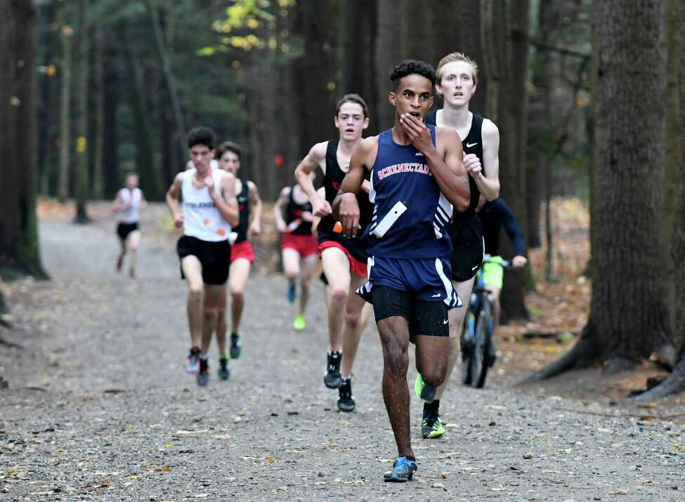 Maazin Ahmed of Schenectady heads out of the forest and on to win the Class A boys sectional cross country meet at Saratoga Spa State Park on Friday, Nov. 3, 2017, in Saratoga Springs, N.Y. (Will Waldron/Times Union)