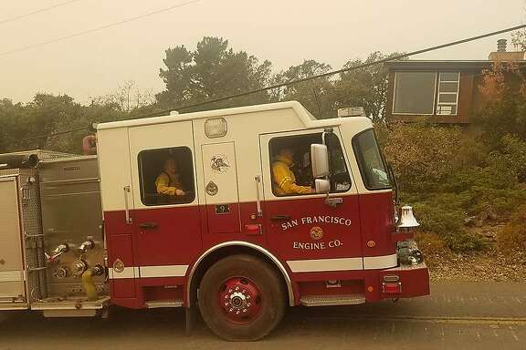 A fire engine from San Francisco's Station 9 site guard over a residential neighborhood in Mission Highlands above Sonoma during the Wine Country fires.