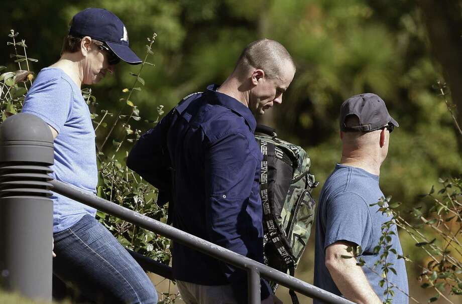 Bowe Bergdahl, center, leaves the Fort Bragg courtroom facility following sentencing at Fort Bragg, N.C., Friday, Nov. 3, 2017. The former Sergeant was spared any prison time and received a dishonorable discharge from the Army. Bergdahl, who walked off his base in Afghanistan in 2009 and was held by the Taliban for five years, pleaded guilty to desertion and misbehavior before the enemy. (AP Photo/Gerry Broome) Photo: Gerry Broome, STF / Associated Press / Copyright 2017 The Associated Press. All rights reserved.
