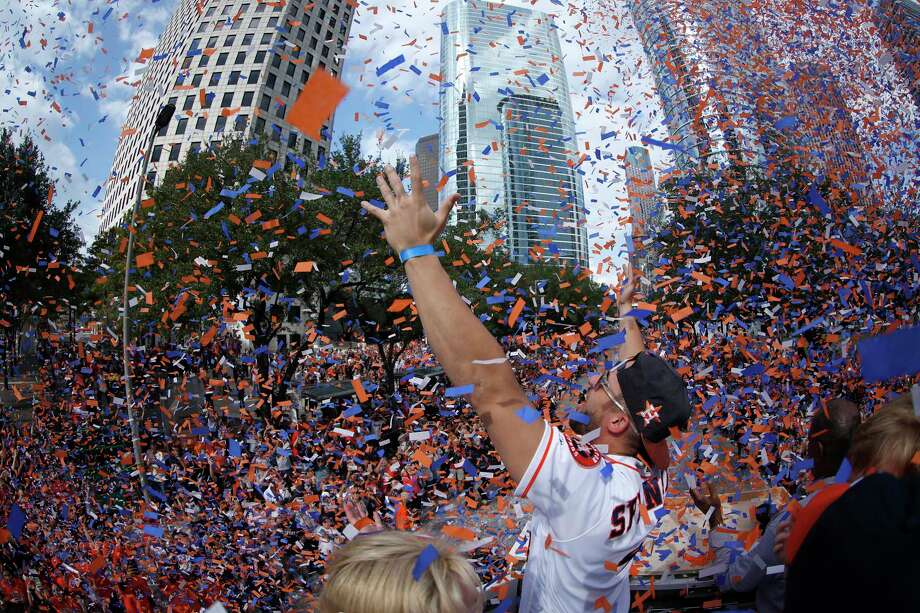 Houston Astros World Series MVP George Springer puts his arms up as the confetti flies as he rode in the bucket truck of HPD Tower truck 69 during the Houston Astros World Series victory parade downtown on Friday, Nov. 3, 2017, in Houston. Photo: Karen Warren, Houston Chronicle / © 2017 Houston Chronicle