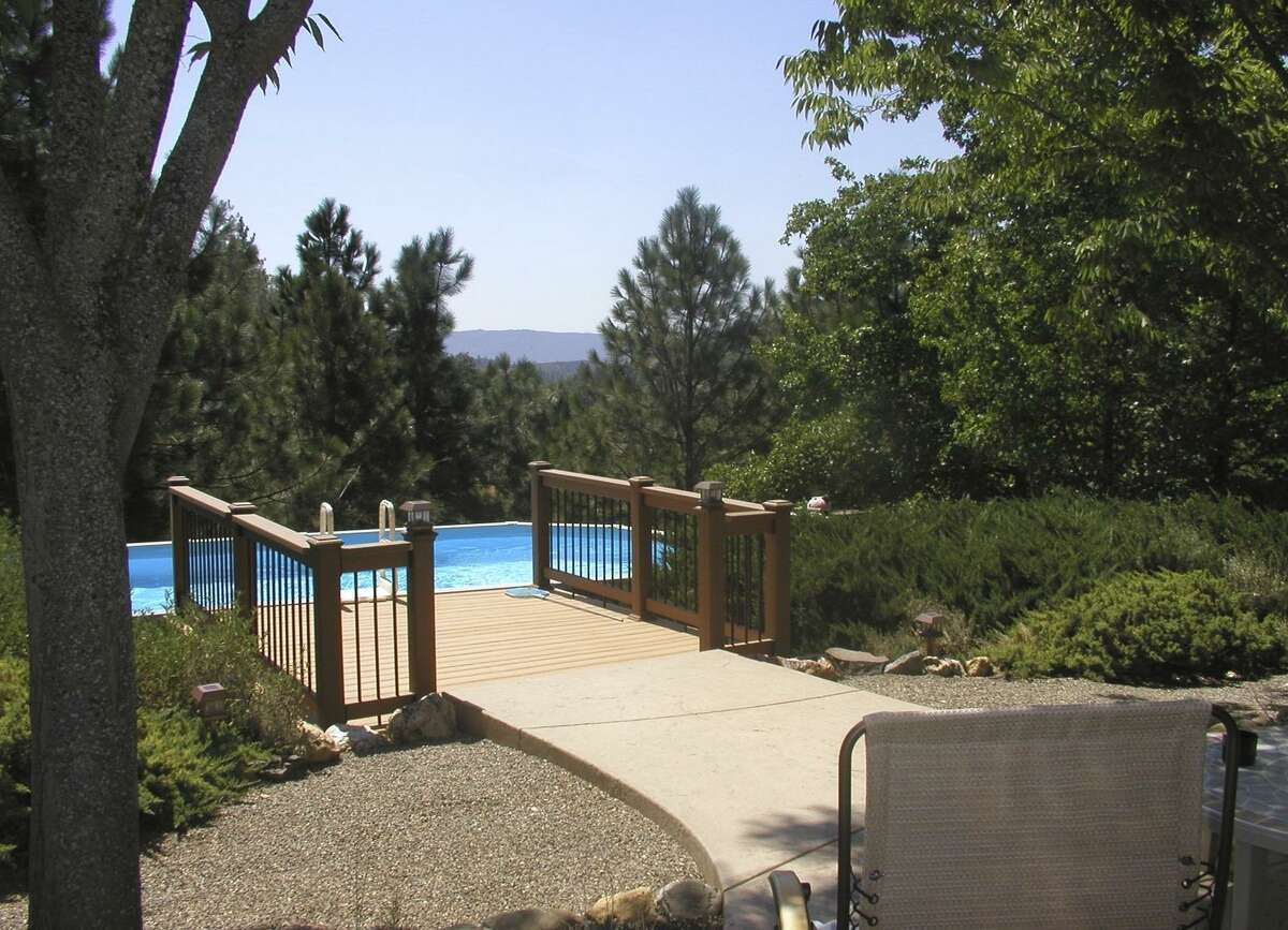 The deck and pool at Mark and Susan Bowe's Calaveras County home commanded a serene mountain view.