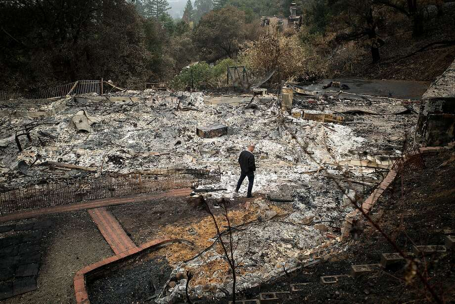 Dan Nielson, whose home in Santa Rosa was leveled by the Tubbs Fire, fled with his family after they received a warning call on their landline phone. Photo: Noah Berger, Special To The Chronicle