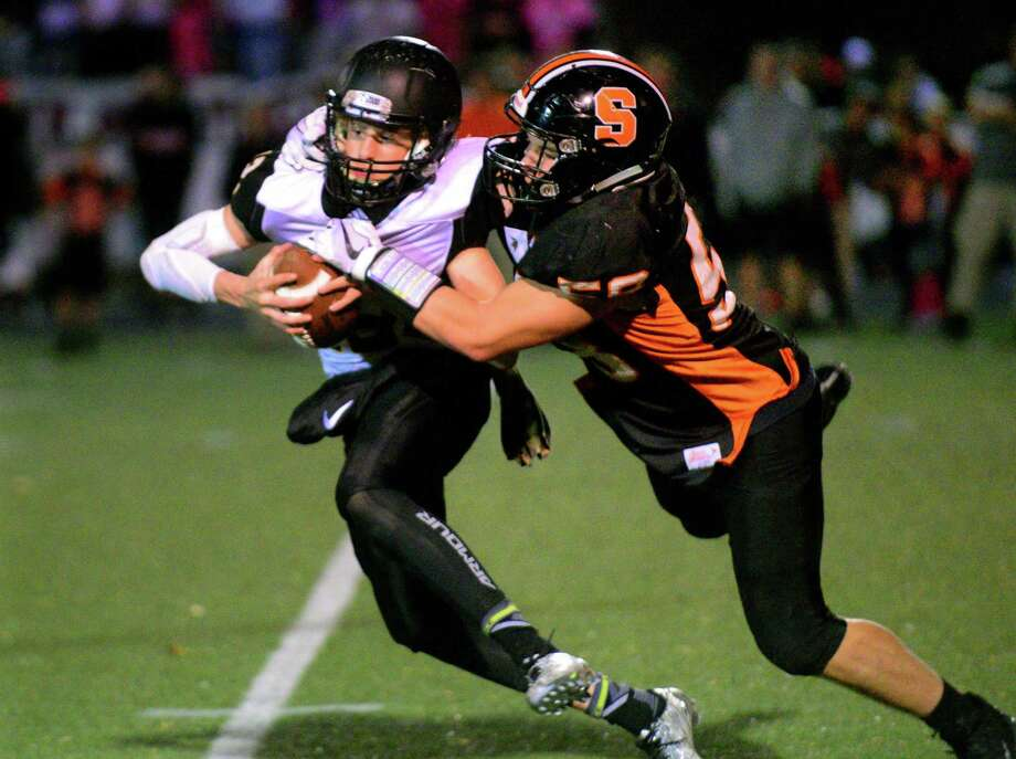 Shelton's Ray Weiner attempts to tackle Amity QB James Laubstein during football action in Shelton, Conn. on Friday Nov. 3, 2017. Photo: Christian Abraham / Hearst Connecticut Media / Connecticut Post