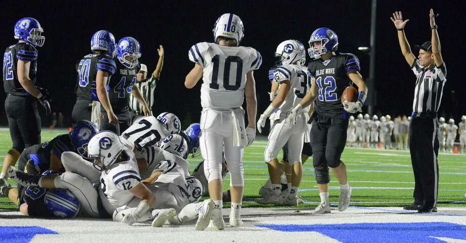 The officials signal touchdown for Darien's Mitchell Pryor (12), scoring on a goal line stance against Wilton in the fourth quarter of a FCIAC boys football game at Darien High School in Darein, Connecticut on Friday, Nov. 3, 2017. Photo: Matthew Brown / Hearst Connecticut Media / Stamford Advocate