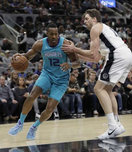 James' triple-double helps Cavaliers squeak past Hornets