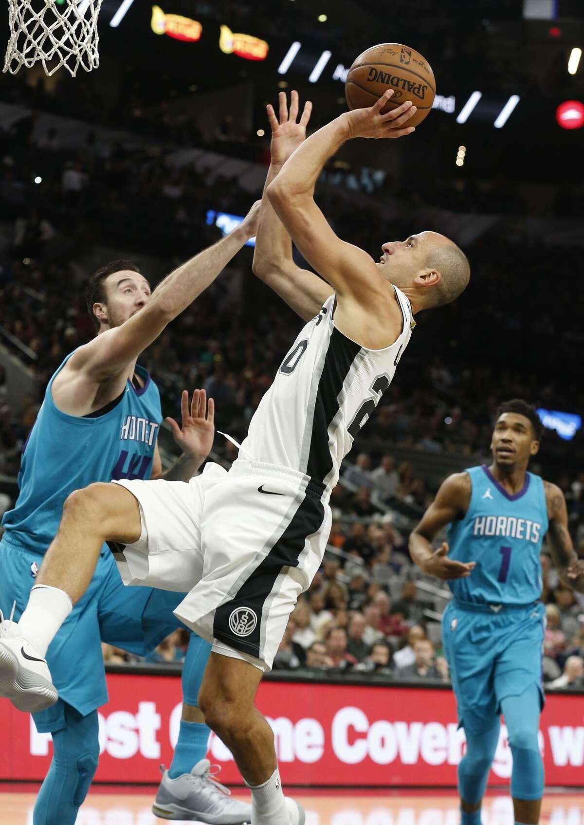 Spurs' Manu Ginobili (20) takes a shot against Charlotte Hornets' Frank Kaminsky (44) at the AT&T Center on Friday, Nov. 3, 2017. (Kin Man Hui/San Antonio Express-News)
