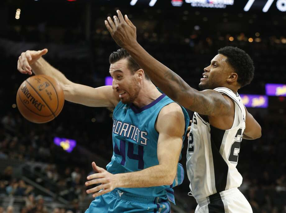 Spurs' Rudy Gay (22) battle for a rebound against Charlotte Hornets' Frank Kaminsky (44)1 at the AT&T Center on Friday, Nov. 3, 2017. (Kin Man Hui/San Antonio Express-News)