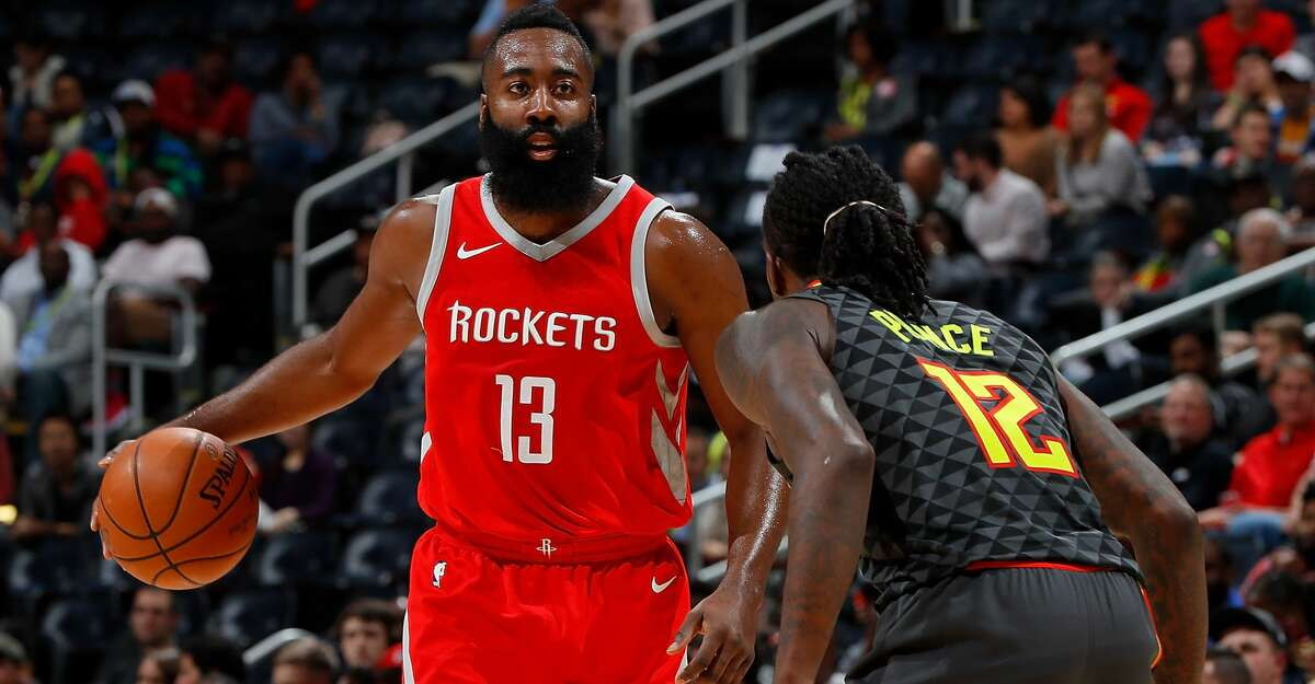 ATLANTA, GA - NOVEMBER 03: James Harden #13 of the Houston Rockets looks to drive against Taurean Prince #12 of the Atlanta Hawks at Philips Arena on November 3, 2017 in Atlanta, Georgia. NOTE TO USER: User expressly acknowledges and agrees that, by downloading and or using this photograph, User is consenting to the terms and conditions of the Getty Images License Agreement. (Photo by Kevin C. Cox/Getty Images)