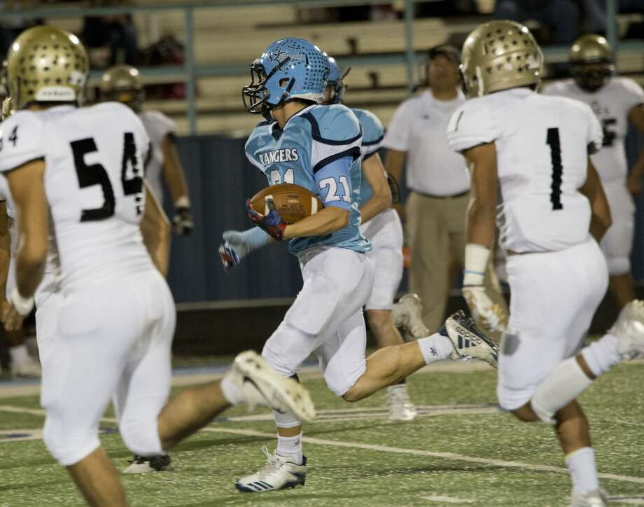 Greenwod's Seth Weatherby looks for more yards as he is chased by Lamesa players 11/03/17 at J.M. King Memorial Stadium. Tim Fischer/Reporter-Telegram Photo: Tim Fischer/Midland Reporter-Telegram