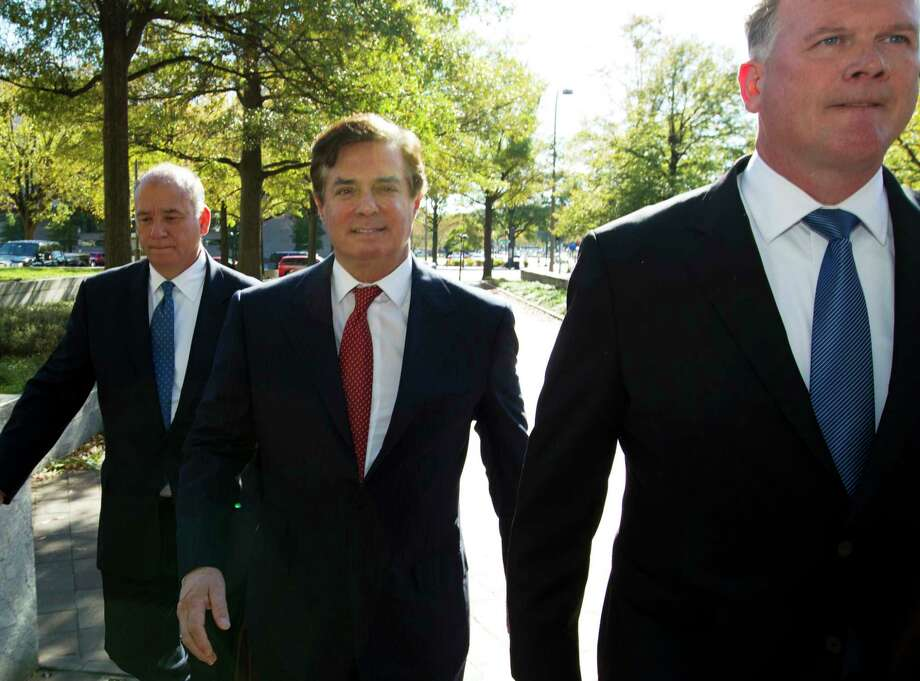 Paul Manafort accompanied by his lawyers, arrives at Federal Court, in Washington, Thursday, Nov. 2, 2017. Manafort, President Donald Trump's former campaign chairman, and Manafort's business associate Rick Gates have pleaded not guilty to felony charges of conspiracy against the United States and other counts. ( AP Photo/Jose Luis Magana) Photo: Jose Luis Magana, FRE / FR159526 AP