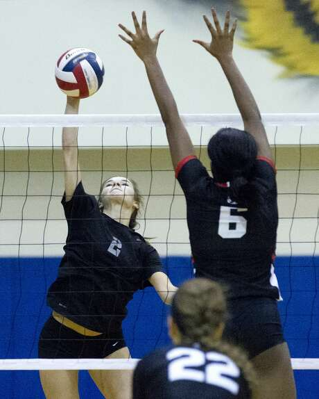 Oak Ridge right side hitter Kenzie Arent (2) gets a shot past Coppell outside hitter Amarachi Osuji (6) during the first set of a Region II-6A area volleyball match at Corsicana High School, Friday, Nov. 3, 2017, in Corsicana. Photo: Jason Fochtman/Houston Chronicle