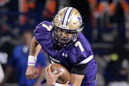 Midland High's Suddin Sapien (7) runs on a a keeper against San Angelo Central on Nov. 3, 2017, at Grande Communications Stadium. James Durbin/Reporter-Telegram