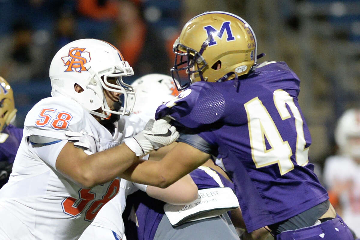 Midland High's Logan Simmons (42) faces off against San Angelo Central's Oscar Nino (58) on Nov. 3, 2017, at Grande Communications Stadium. James Durbin/Reporter-Telegram
