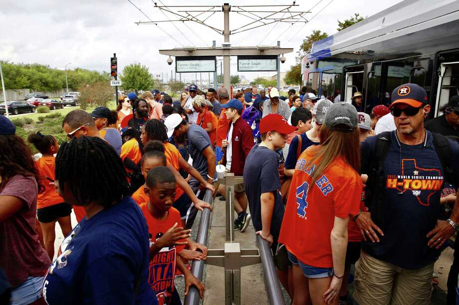 Metro trains already packed with riders leave no room Friday for the hundreds of people waiting in line at the Fannin South Transit Center hoping to catch a free ride downtown for the Astros' championship parade. Photo: Mark Mulligan, Astros_Parade_Metro / 2017