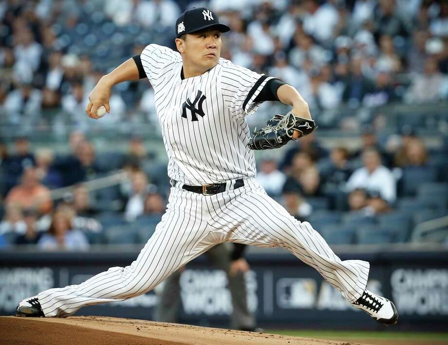 Yankees righthander Masahiro Tanaka on Friday chose not to opt out of the remaining three seasons of his contract and become a free agent. Photo: Karen Warren, Staff / © 2017 Houston Chronicle
