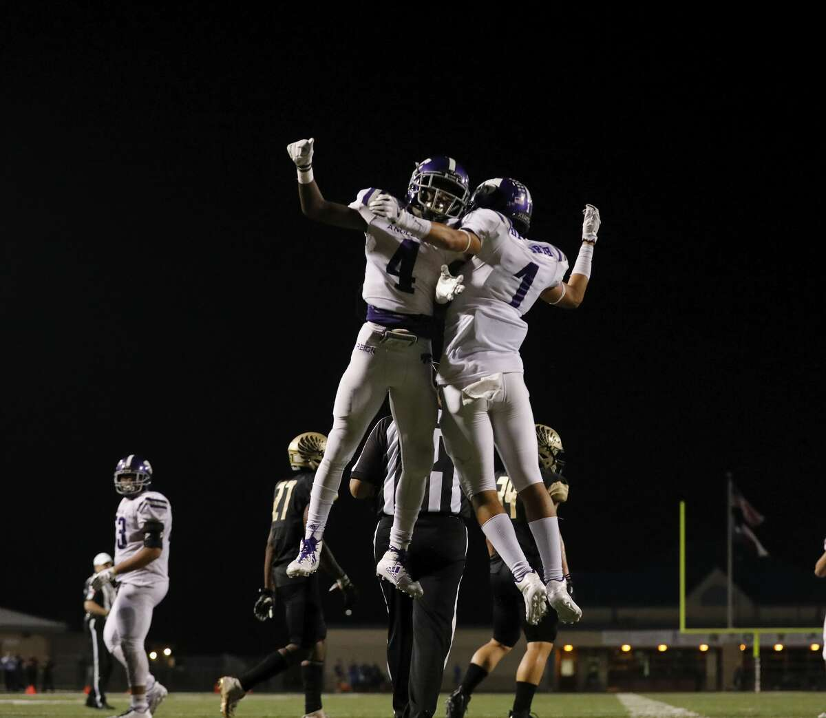 Angleton Wildcats My'kell Ross (4) celebrates with Cameron Dilworth (1) after a touchdown in the third quarter during the high school football game between Angleton Wildcats and the Foster Falcons in Rosenberg, TX on Friday, November 03, 2017.