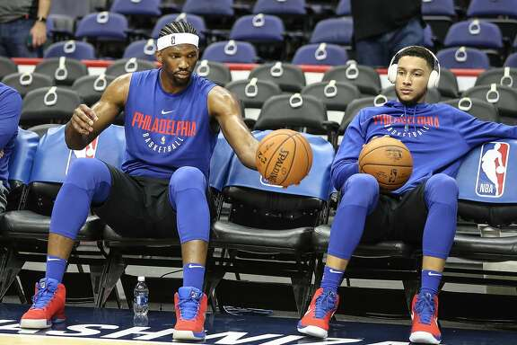 The Philadelphia 76ers' Joel Embiid, left, and Ben Simmons watch warm-ups before a game against the Washington Wizards at the Capital One Arena in Washington, D.C., on Wednesday, Oct. 18, 2017. The Wizards won, 120-115. (Steven M. Falk/Philadelphia Inquirer/TNS)