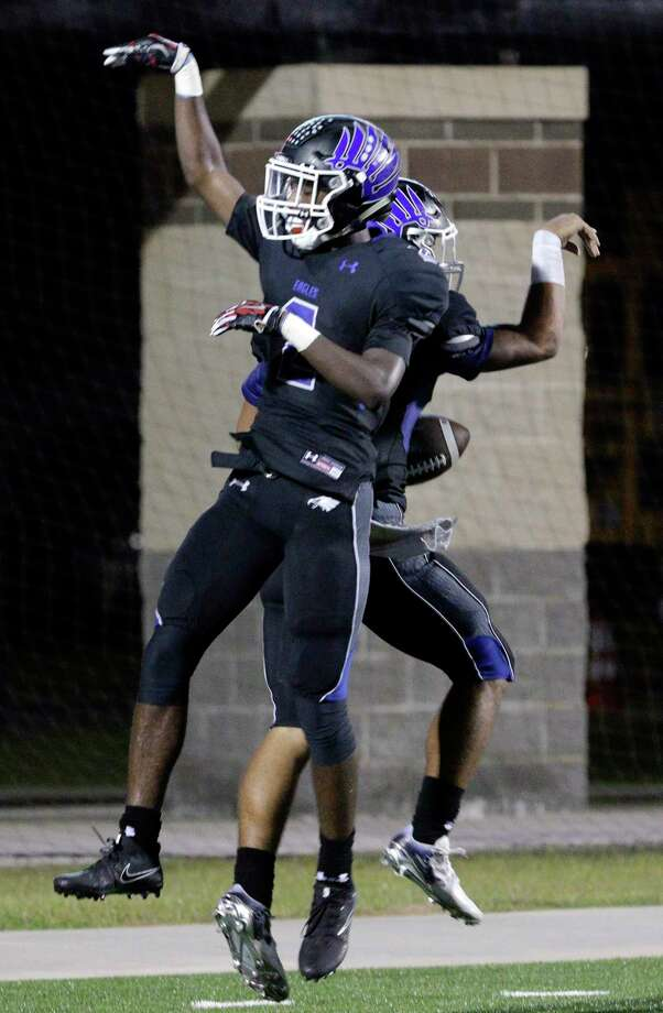 New Caney's Dwight McGlowthern (2) and Jordan Cooper (10) celebrate Cooper's touchdown in the second half of their game against Porter, Nov. 3, 2017, in Porter, TX. (Michael Wyke / For the  Chronicle) Photo: Michael Wyke, Freelance / © 2017 Houston Chronicle