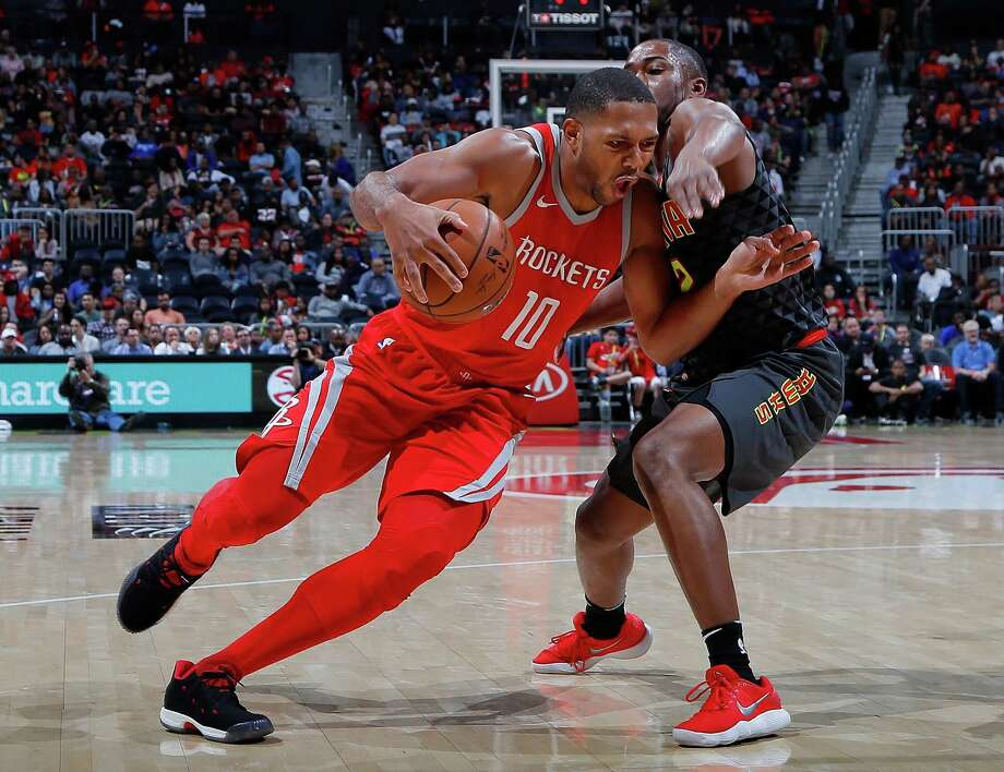 Rockets guard Eric Gordon, left, tries to cut corners on Isaiah Taylor and force his way to the basket. Gordon scored 20 points on 6 for 13 shooting from the field to go with five assists. Photo: Kevin C. Cox, Staff / 2017 Getty Images