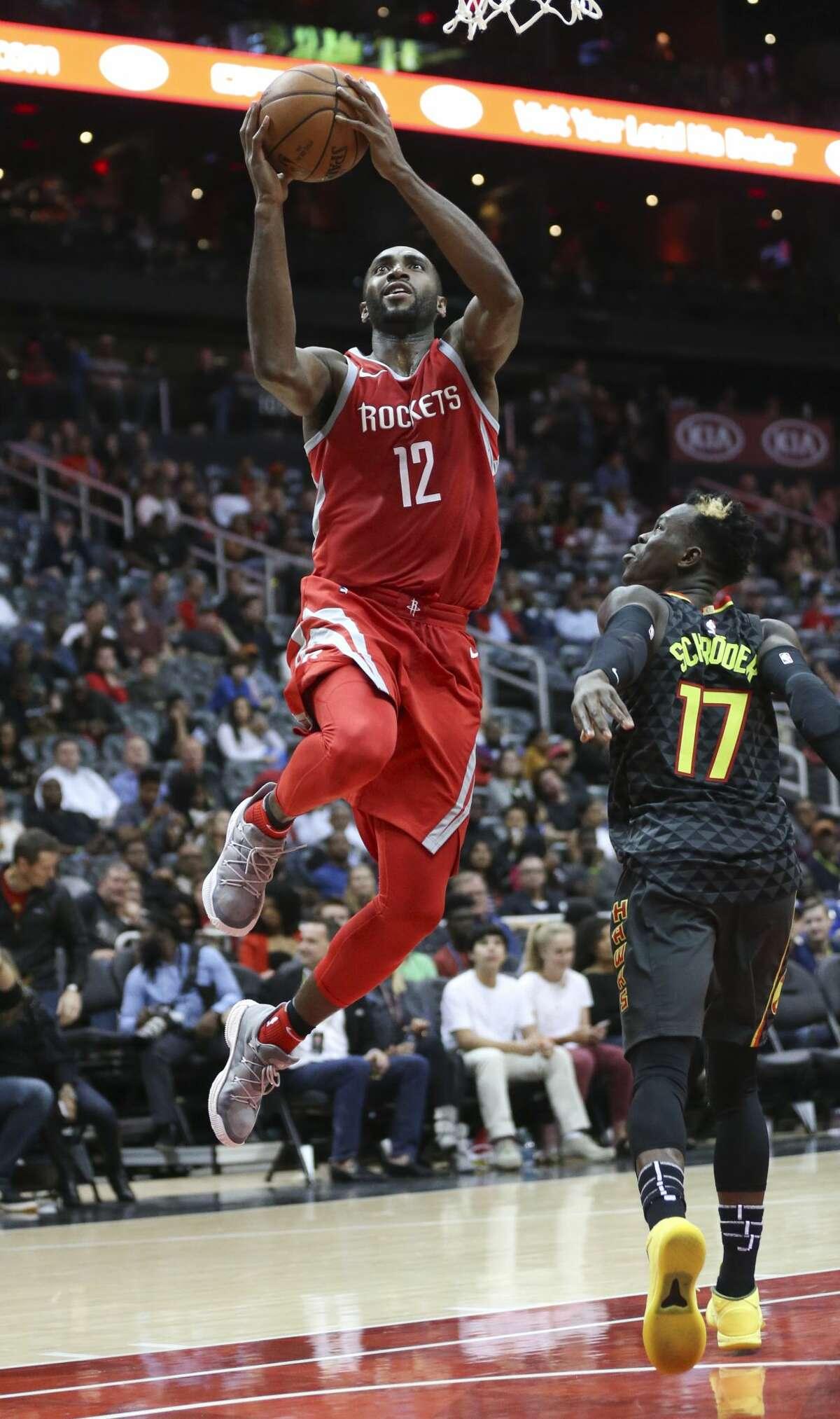 Houston Rockets forward Luc Mbah a Moute (12) drives against Atlanta Hawks guard Dennis Schroder (17) in the second half of an NBA basketball game Friday, Nov. 3, 2017, in Atlanta. (AP Photo/John Bazemore)