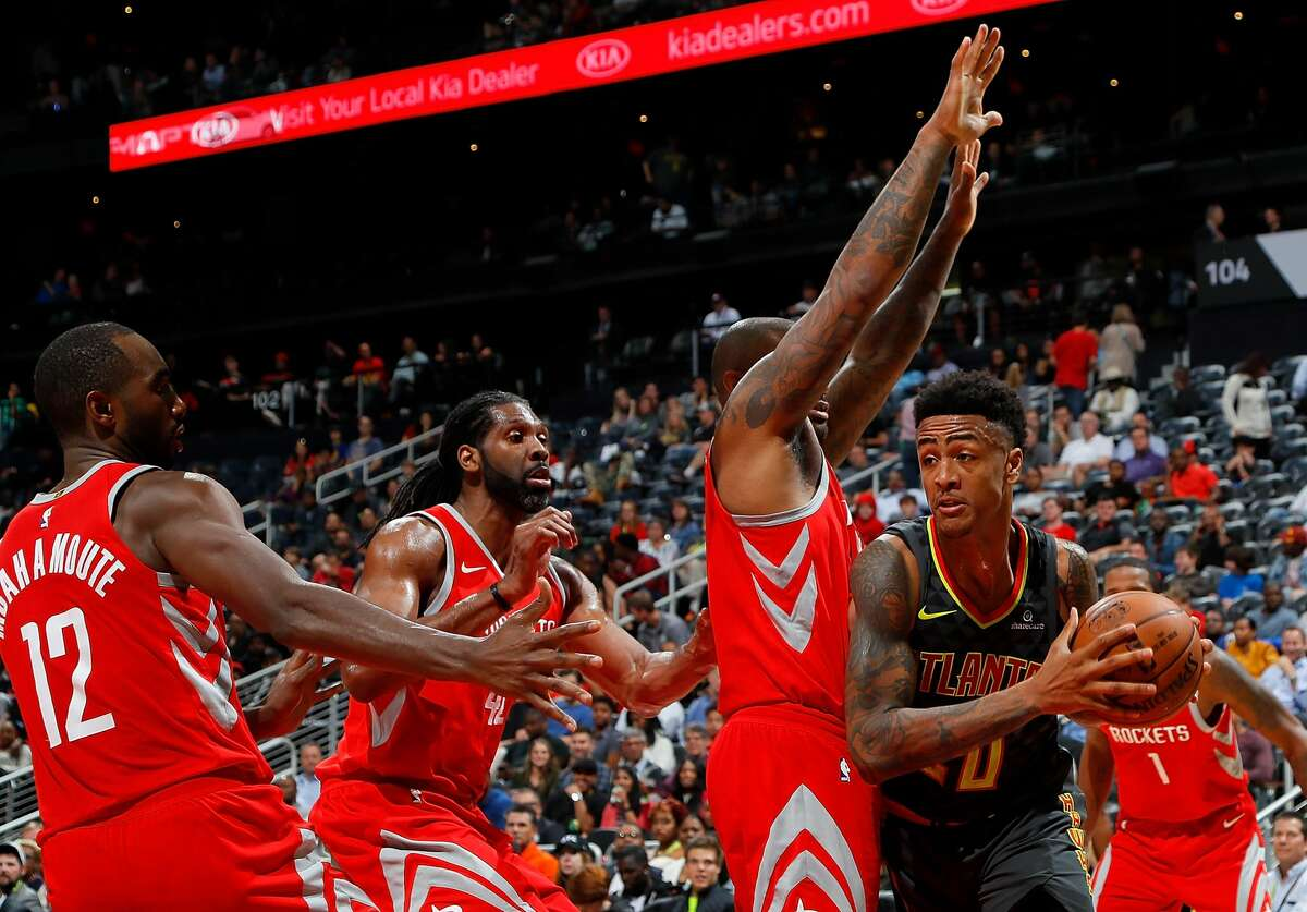 ATLANTA, GA - NOVEMBER 03: John Collins #20 of the Atlanta Hawks is defended by PJ Tucker #4, Nene Hilario #42 and Luc Mbah a Moute #12 of the Houston Rockets at Philips Arena on November 3, 2017 in Atlanta, Georgia. NOTE TO USER: User expressly acknowledges and agrees that, by downloading and or using this photograph, User is consenting to the terms and conditions of the Getty Images License Agreement. (Photo by Kevin C. Cox/Getty Images)