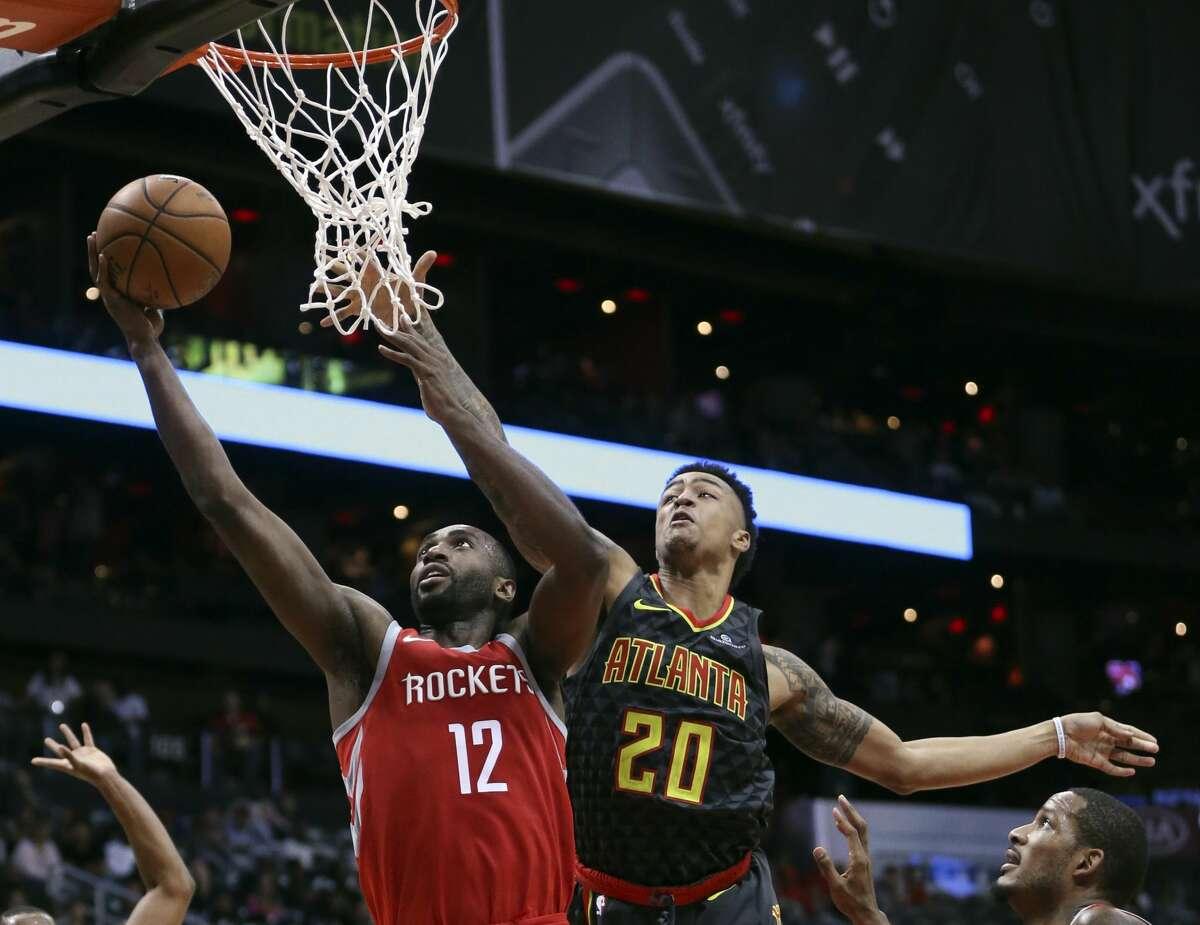 Houston Rockets forward Luc Richard Mbah a Moute (12) goes to the basket as Atlanta Hawks forward John Collins (20) defends during the second half of an NBA basketball game Friday, Nov. 3, 2017, in Atlanta. (AP Photo/John Bazemore)
