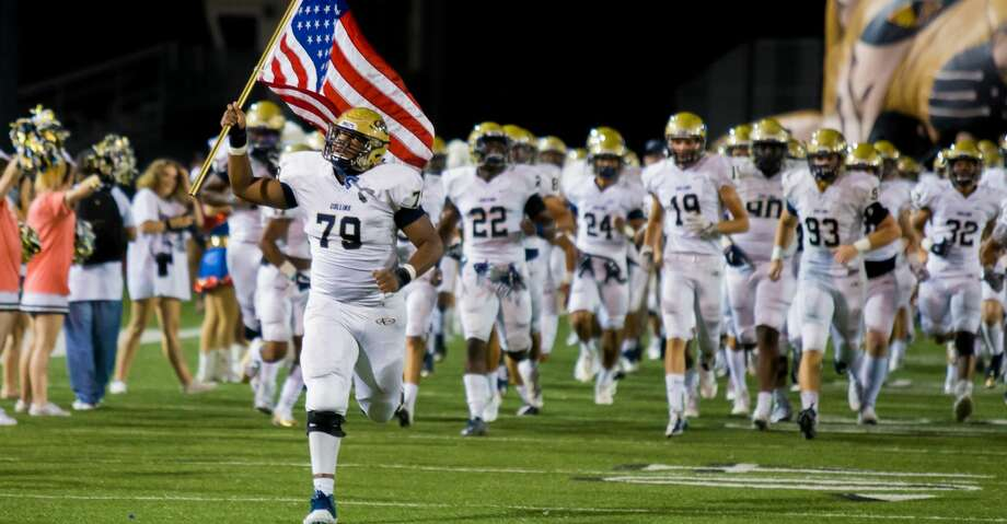 Klien Collins OL Kenneth Coward (79) leads the team on the field with the American flag during the prior to the first half of action between Klein vs. Klein Collins high schools during a football game at Memorial Stadium, Friday, November 3, 2017, in Spring. (Juan DeLeon/for the Houston Chronicle) Photo: Juan DeLeon/For The Chronicle