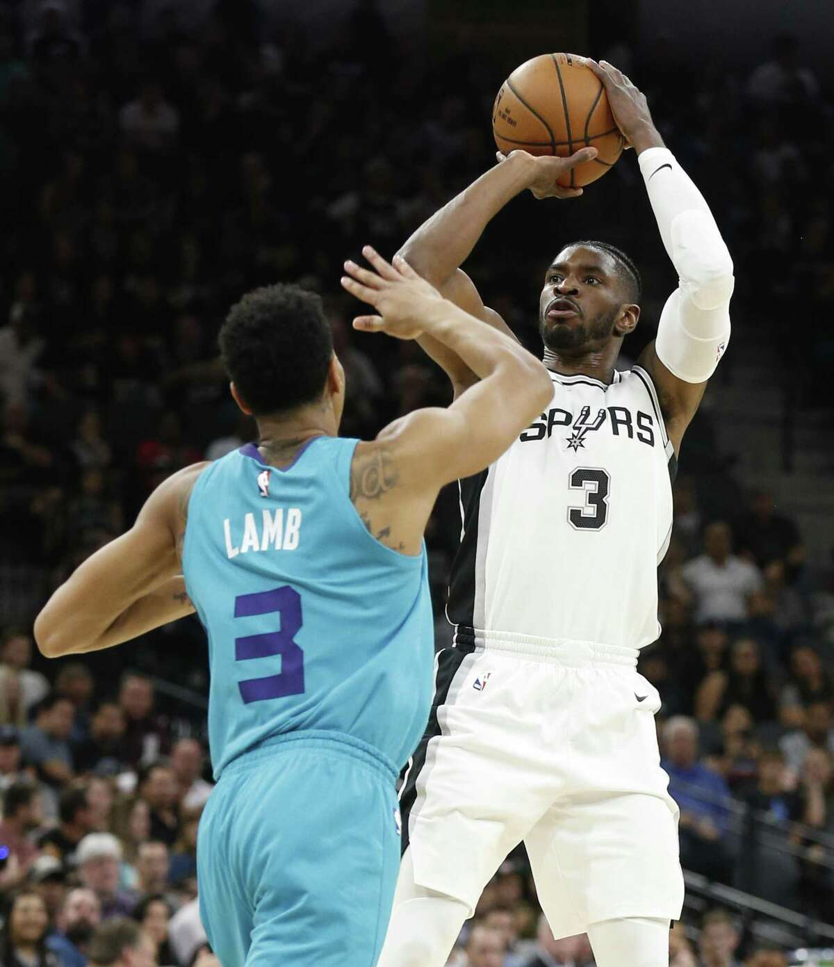 Spurs' Brandon Paul (03) attempts a shot against Charlotte Hornets' Jeremy Lamb (left) at the AT&T Center on Friday, Nov. 3, 2017. (Kin Man Hui/San Antonio Express-News)