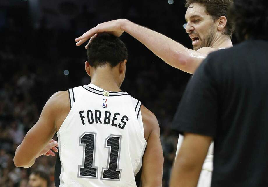 Spurs' Pau Gasol, right, congratulates Bryn Forbes after a score against the Charlotte Hornets in the second half at the AT&T Center on Friday, Nov. 3, 2017. Spurs defeated the Hornets, 108-101. Photo: Kin Man Hui /San Antonio Express-News / ©2017 San Antonio Express-News