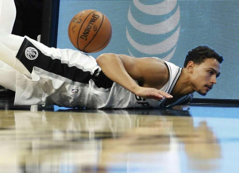 Spurs' Bryn Forbes (11) slides on the floor while trying to save a ball against the Charlotte Hornets in the second half at the AT&T Center on Friday, Nov. 3, 2017. Spurs defeated the Hornets, 108-101. (Kin Man Hui/San Antonio Express-News) Photo: Kin Man Hui, Staff / San Antonio Express-News / ©2017 San Antonio Express-News