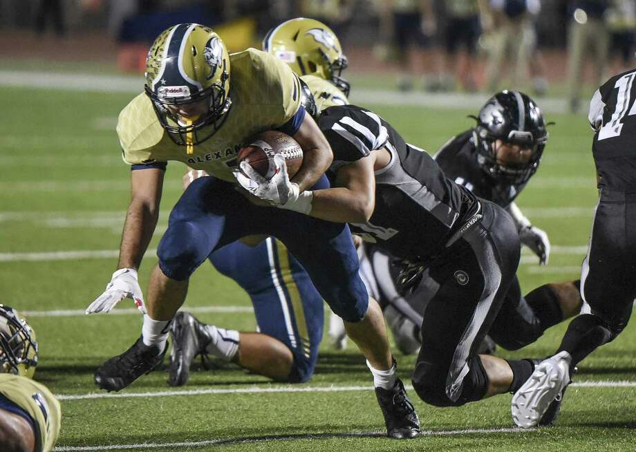 United South High School Cesar Contreras tackles Alexander High School running back Camilo Pedraza as he nears the goal line during a game on Friday, Nov. 3, 2017 at the Student Activity Complex. Photo: Danny Zaragoza / Laredo Morning Times File