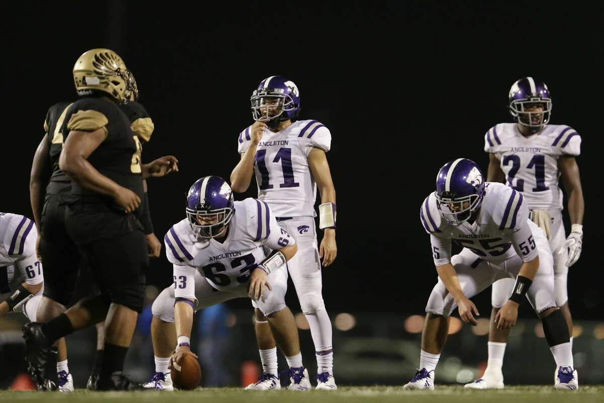 Angleton Wildcats Seth Cosme (11) prepares to take the snap from Johnathan Stanzel (63) in the second half during the high school football game between Angleton Wildcats and the Foster Falcons in Rosenberg, TX on Friday, November 03, 2017. The Wildcats defeated the Falcons 34-7.