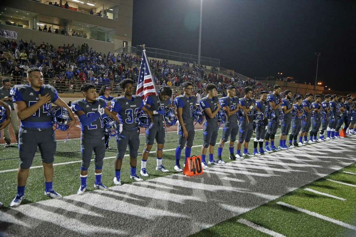 Memorial players stand for the Anthem from the District 28-5A high school football game between Memorial and Highlands on Friday, November 3, 2017 at Edgewood Memorial Stadium.