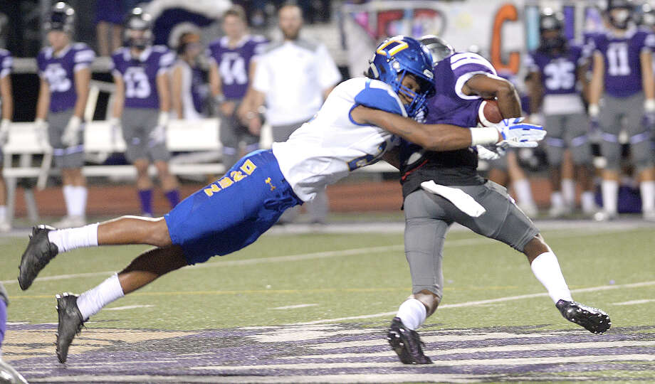 Port Neches - Groves' Khaleb Taylor is tackled by Ozen's Deon Lewis during their district mach-up at PNG Friday. Photo taken Friday, November 3, 2017 Kim Brent/The Enterprise Photo: Kim Brent / BEN