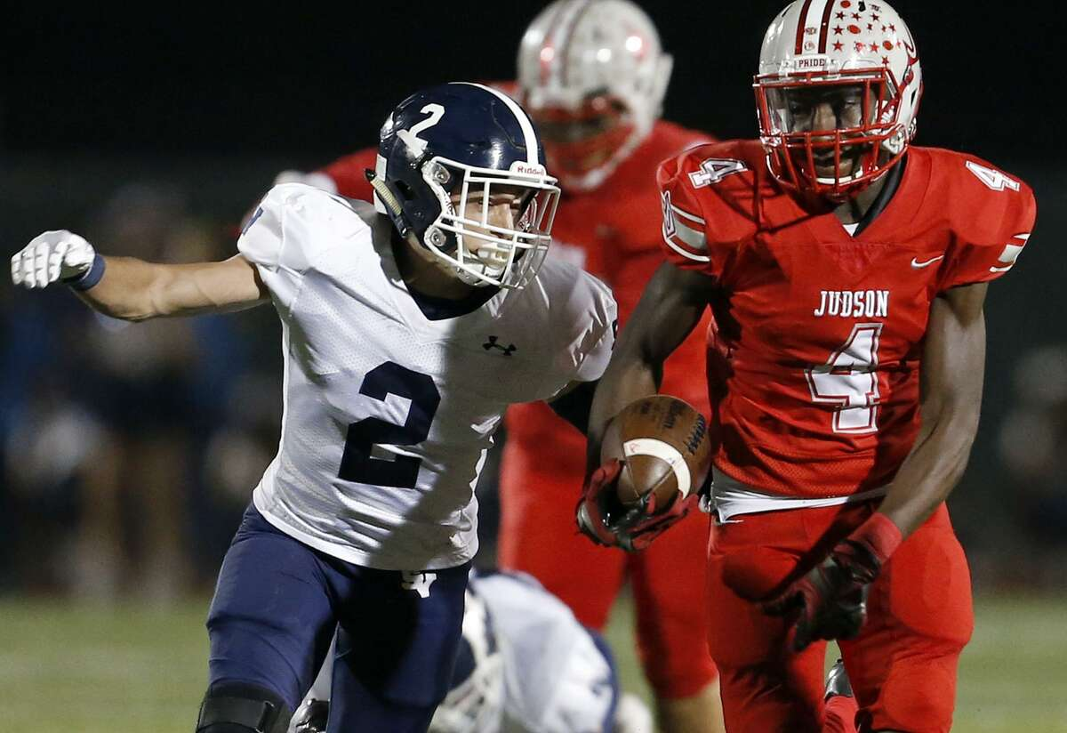 Judson's Keith Jefferson looks for room around Smithson Valley's Jacob Johnson during first half action Friday Nov. 3, 2017 at Rutledge Stadium.