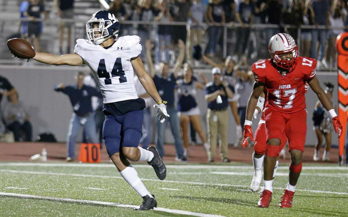 Smithson Valley's Tre-Von Moehrig-Woodward stretches for the game winning touchdown ahead of Judson's Christopher Mills in overtime action Friday Nov. 3, 2017 at Rutledge Stadium. Smithson Valley won in overtime 40-37.