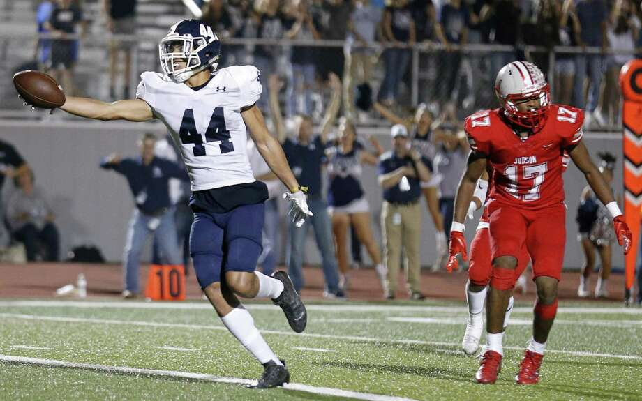 Smithson Valley's Tre-Von Moehrig-Woodward stretches for the game winning touchdown ahead of Judson's Christopher Mills in overtime action Friday Nov. 3, 2017 at Rutledge Stadium. Smithson Valley won in overtime 40-37. Photo: Edward A. Ornelas, Staff / San Antonio Express-News / © 2017 San Antonio Express-News