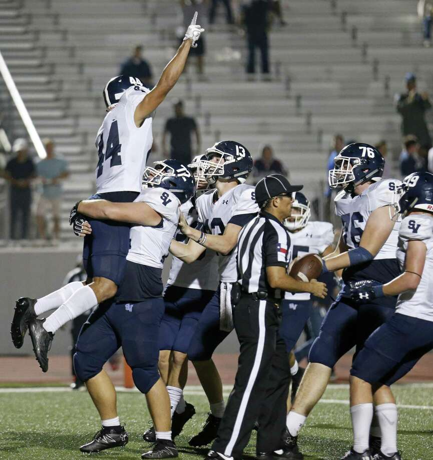 Smithson Valley's Tre-Von Moehrig-Woodward (left) celebrates with teammates after scoring the game winning touchdown in overtime action against Judson Friday Nov. 3, 2017 at Rutledge Stadium. Smithson Valley won in overtime 40-37. Photo: Edward A. Ornelas, Staff / San Antonio Express-News / © 2017 San Antonio Express-News