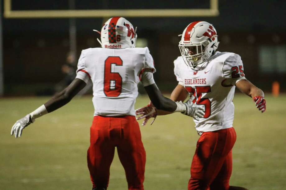 The Woodlands' Bryeton Gilford (25) celebrates with Kesean Carter (6) after scoring a touchdown during the varsity football game against Montgomery on Friday, Nov. 3, 2017, at Bears Stadium in Montgomery. (Michael Minasi / Houston Chronicle) Photo: Michael Minasi, Staff Photographer / © 2017 Houston Chronicle