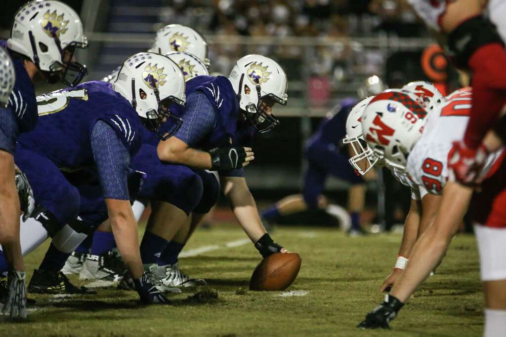 The Montgomery Defensive Line Faces Off With The Woodlands During The Varsity Football Game On Friday