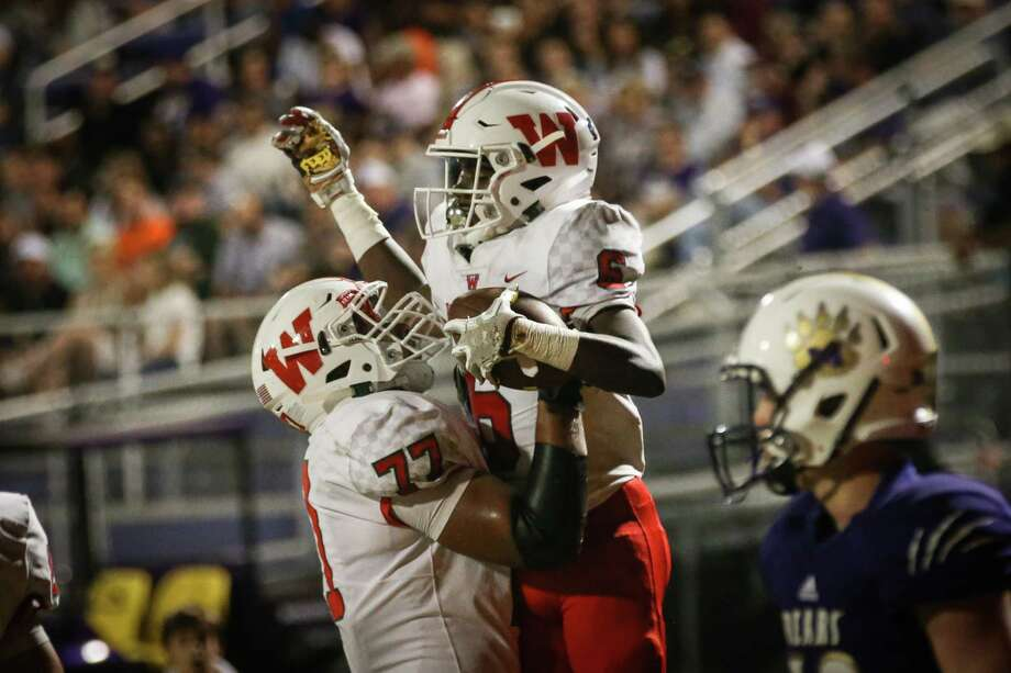 The Woodlands' Kesean Carter (6) is lifted by Peyton Fifield (77) after scoring a touchdown during the varsity football game against Montgomery on Friday, Nov. 3, 2017, at Bears Stadium in Montgomery. (Michael Minasi / Houston Chronicle) Photo: Michael Minasi, Staff Photographer / © 2017 Houston Chronicle