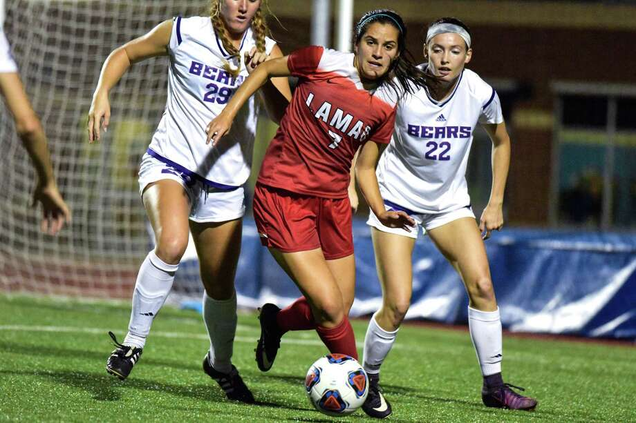 Lamar's Samantha Moreno, center, moves the ball between a pair of Central Arkansas defenders during their Southland Conference Tournament semifinal game in Corpus Christi. Lamar won, 2-1, to advance to Sunday's final. (Charlie Blalock/Southland Conference) Photo: Charlie Blalock/Southland Confer