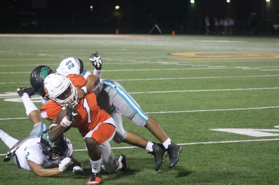 Matthew Garcia (29) and Trevor Robinson tackle La Porte's De'Jon Bright. Highlighted by three interceptions, the defense did its part to keep the team perfect in 22-6A games. Photo: Robert Avery