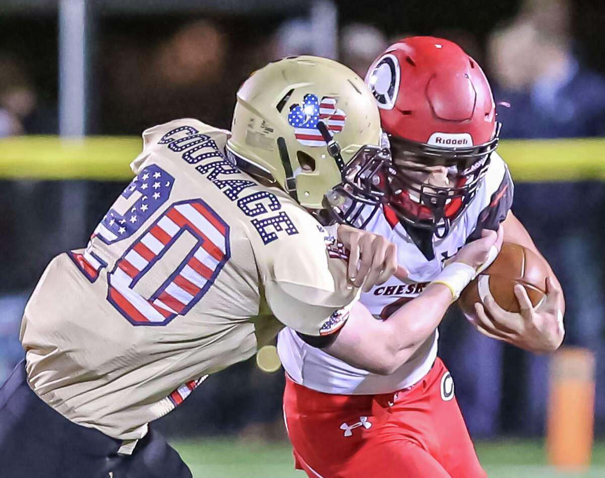 (John Vanacore/ For Hearst Connecticut Media) Connecticut High School Football action from Friday, November 3, 2017 featuring SCC foes Hand Tigers vs Cheshire Rams. The Togers of Daniel Hand defeated the Cheshire Rams 20-12.