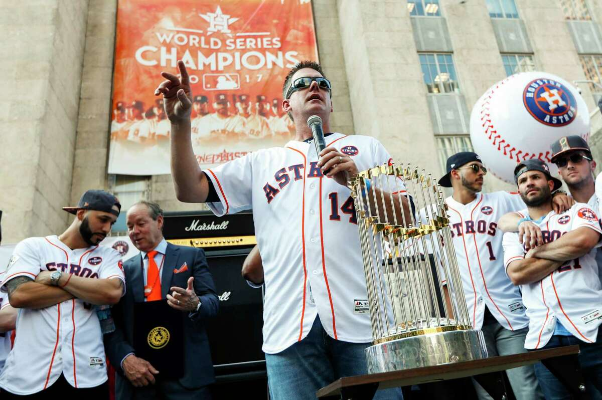 Following a championship parade through Houston streets, Astros manager A.J. Hinch, center, thanks everyone during a celebration at City Hall. He has continued to be a conduit of good feelings between players and fans in the weeks since.