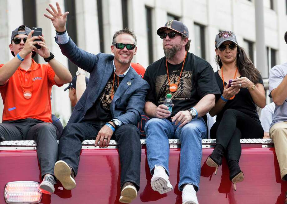 Astros Hall of Famers Craig Biggio, left, and Jeff Bagwell were happy to go along for the ride during the first World Series victory parade in franchise history on Friday. Photo: Brett Coomer, Staff / © 2017 Houston Chronicle