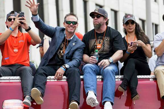 Astros Hall of Famers Craig Biggio, left, and Jeff Bagwell were happy to go along for the ride during the first World Series victory parade in franchise history on Friday.